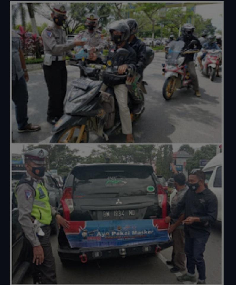 Polres Rohul Bagikan Masker Di Jalan-jalan
